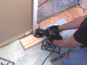 Undercut any door jambs or other trim that might interfere with the flooring installation.