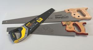 Shown are three European-pattern hand saws.