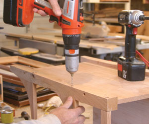 Screws covered with walnut plugs provide extra strength