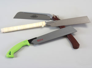 Shown are three Japanese-pattern saws.