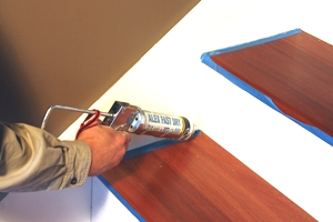 Caulk all seams on the risers and skirt boards