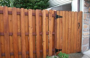 """Front side of single-door gate. The post on the """"latch"""" side of the gate is mounted to the cinder block wall with toggle bolts."""