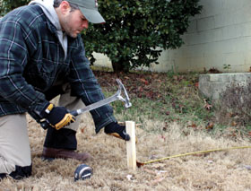 Mark off your fence layout with stakes and twine.