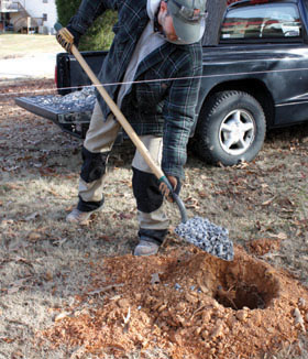 "Fill each post hole with 4"" to 6"" of gravel to allow drainage."