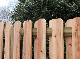 This shadowbox-style of fence features alternating pickets for extra depth and some degree of see-through visibility.