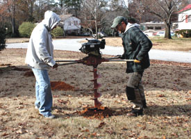 A rented two-man power auger and an electric demolition hammer helped greatly when digging the holes.