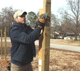 Use a story pole to mark your stringer locations along the posts.