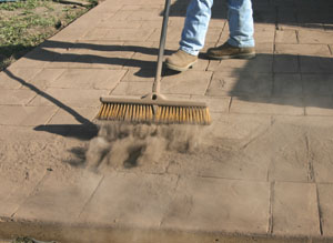 Sweep off the excess powder. If possible, capture the excess powder for proper disposal.