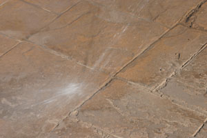 Using a pressure washer with at least 2,000 psi, wash the remaining powder from the surface.