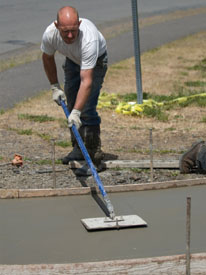Shawn Joslin adds a joint line to his walkway project.