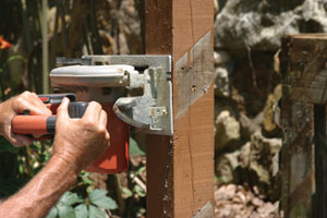 Using a hand or circular saw, cut the posts to the correct height.