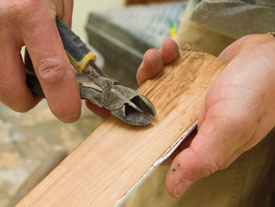 Pull nails through the back of a piece of baseboard to avoid damaging the face.