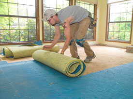 The carpet pad can usually be rolled up as it's being removed.
