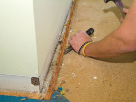 A chisel, flat bar or putty knife can be used to pry up carpet tack strips from the subfloor.