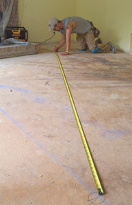 Take time to establish some layout lines before beginning the hardwood floor install.