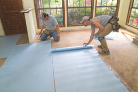 Roll out the foam backer pad perpendicular to the directin that your flooring will be installed.