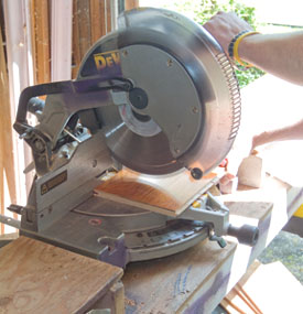 A miter saw with enough cut width is the right tool to cut engineered hardwood flooring to length.