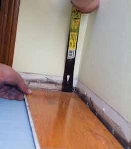 A flat bar can be used to pry the boards away from the wall to close the head joint gaps.