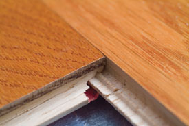 A close look shows how the tongue and groove has an extra ridge and a V notch to lock the pieces together.