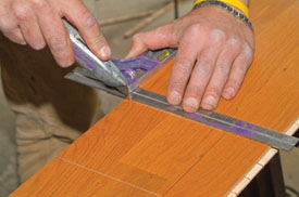 Use masking tape on the base of the jigsaw to guard against scratches on the prefinished flooring.