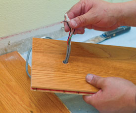 Be sure to pull the slack out of the wires before placing the floor board into the final position.