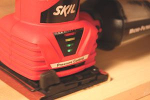 Skil's new 1/4- sheet palm sander features Pressure Control Technology that warns the user when excessive pressure is applied.