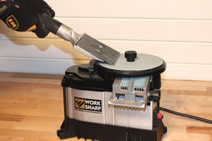 The Work Sharp system uses an abrasive pad on a glass wheel for sharpening all sorts of tools, from chisels and flat blades to lathe tools and scrapers.