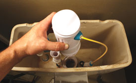 Reattach the flush valve to its base, locking it in place with a quarter turn.
