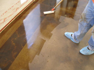 Solvent-based sealer is applied with a durable roller; a solvent sealer will darken the stain color and hold it at its