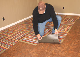 Adhesive discs, included with the carpet squares, are all that's required to hold the Flor tiles in place.