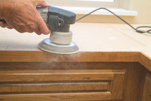 When preparing countertops for laminate, sand everything flat and smooth including seams and the self-edge connection.
