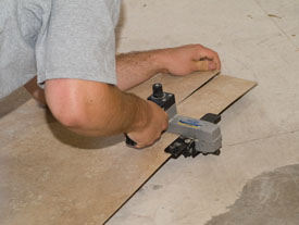 We use this Virutex CO15L Laminate Slitter/Cutter for making backsplash laminate pieces and counter edge strips.