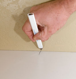 In most cases you will be fitting the laminate precisely to the walls, so it's a good idea to put some reference points on the plastic as well as on the wall, which aids getting the proper alignment when everything is glued.