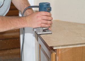 Once the laminate is thoroughly rolled, you can trim it with a router without delay.