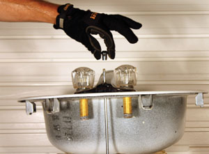 2. Unscrew the cap of the drain's lift rod so the faucet will slip over it.