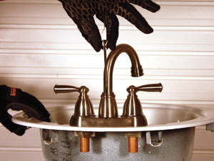 16. Thread the lift rod through the top of the faucet.