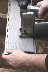 Common woodworking tools will easily cut and drill the PVC material. A jigsaw is a handy tool for cutting notches to install around handrail posts.