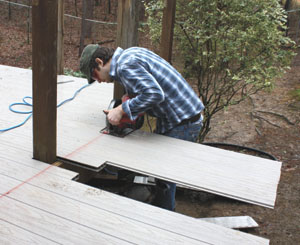 We ran the deck boards long and cut them all at once after installation was complete.