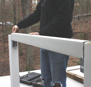 Test-fit the rails over the mounting brackets before final installation.