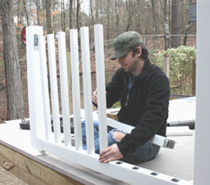 The balusters simply slip into the routed holes of the rails.