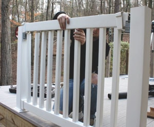 The top rail mounts over the balusters, followed by a rail cover for a comfortable hand grip.