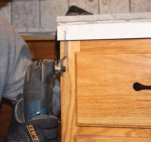An oscillating tool with a plunge-cut blade can make precise notches in trim carpentry, cabinets and countertops.