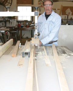 First step is to rip stock construction 2x4's into 1-5/8-inch widths to create the leg-posts.