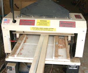 Using a jointer of planer, smooth and cut the sawn edges to create a 1-1/2 inch width.
