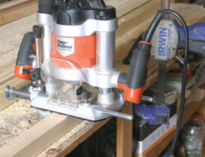 With a plunge router, route a 1/4-inch deep by 3/8-inch wide dado on the inside surfaces of the leg posts. Stop the dado at the location of the top of the bottom leg ends.