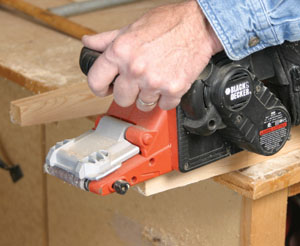Using a belt sander smooth up the cuts on the leg ends.