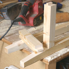 The side cross pieces have tenons cut in them to fit into the leg post dadoes. Cut using a tenoning jig in a table saw, a radial arm saw or by hand with a back saw.