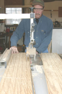 Cut the beadboard crossways at 6 feet to create the back and side pieces. Rip the beadboard sides to width.