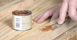 Fill any holes or flaws in the wood, sand and paint the side assemblies inside and out.