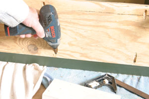Bottom, top and center shelve are anchored in place with picket screws driven into front and cross pieces.